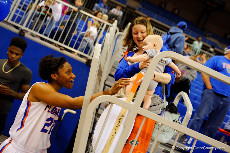 Florida Gators forward Kayla Lewis smiles and talks with a young Gator fan during her senior day.  Florida Gators Womens Basketball vs Georgia Bulldogs.  February 28th, 2015. Gator Country photo by David Bowie.