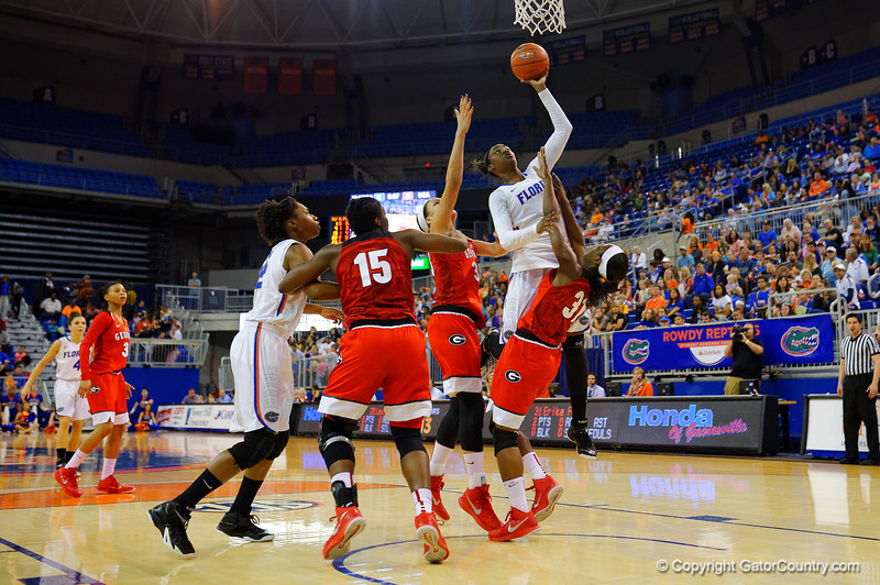 Florida Gators guard Ronni Williams leaps up and through the Georgia defense for a basket in the first half.  Florida Gators Womens Basketball vs Georgia Bulldogs.  February 28th, 2015. Gator Country photo by David Bowie.