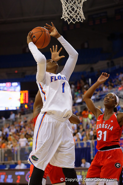 Florida Gators guard Ronni Williams leaps and scores during the first half.  Florida Gators Womens Basketball vs Georgia Bulldogs.  February 28th, 2015. Gator Country photo by David Bowie.