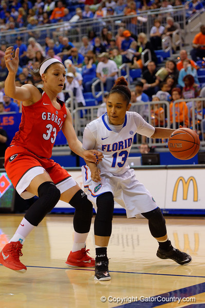 Florida Gators guard Cassie Peoples dirves along the baseline during the first half.  Florida Gators Womens Basketball vs Georgia Bulldogs.  February 28th, 2015. Gator Country photo by David Bowie.