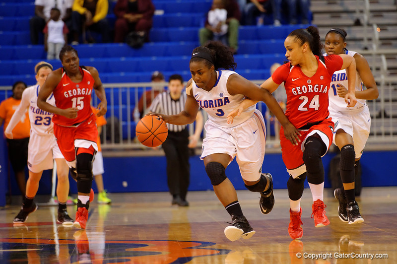 Florida Gators guard January Miller dribbles up court during the second half.  Florida Gators Womens Basketball vs Georgia Bulldogs.  February 28th, 2015. Gator Country photo by David Bowie.