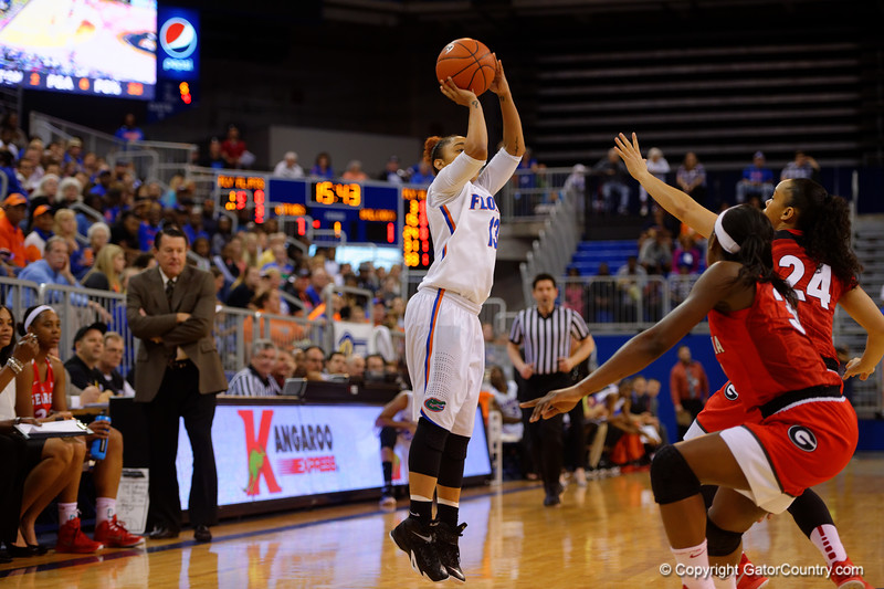 Florida Gators guard Cassie Peoples takes a three point shot during the first half.  Florida Gators Womens Basketball vs Georgia Bulldogs.  February 28th, 2015. Gator Country photo by David Bowie.
