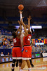 Florida Gators guard Ronni Williams puts up a shot over two Georgia defenders in the second half.  Florida Gators Womens Basketball vs Georgia Bulldogs.  February 28th, 2015. Gator Country photo by David Bowie.