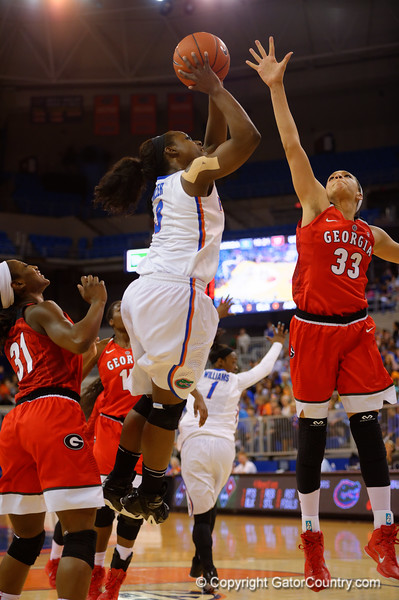 Florida Gators guard January Miller leaps into the air and scores during the first half.  Florida Gators Womens Basketball vs Georgia Bulldogs.  February 28th, 2015. Gator Country photo by David Bowie.