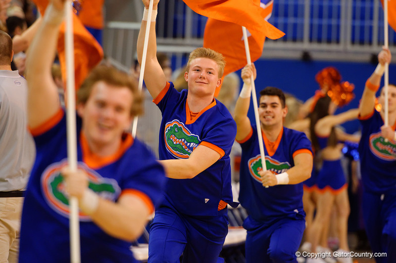 The Florida Gators take the court led by the Gator cheerleaders.  Florida Gators Womens Basketball vs Georgia Bulldogs.  February 28th, 2015. Gator Country photo by David Bowie.