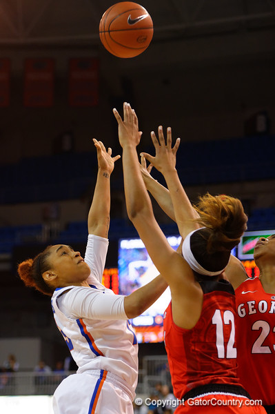Florida Gators guard Cassie Peoples puts up a shot attempt during the first half.  Florida Gators Womens Basketball vs Georgia Bulldogs.  February 28th, 2015. Gator Country photo by David Bowie.
