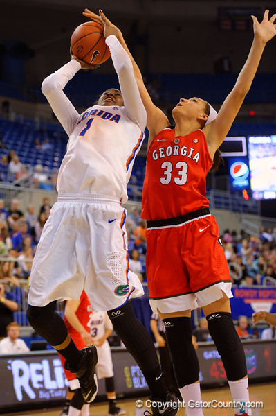 Florida Gators guard Ronni Williams has the ball blocked late in the second half.  Florida Gators Womens Basketball vs Georgia Bulldogs.  February 28th, 2015. Gator Country photo by David Bowie.