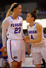Florida Gators guard Carlie Needles comes up to Florida Gators guard Brooke Copeland before Copeland takes her two foul shots.  Florida Gators Womens Basketball vs Georgia Bulldogs.  February 28th, 2015. Gator Country photo by David Bowie.