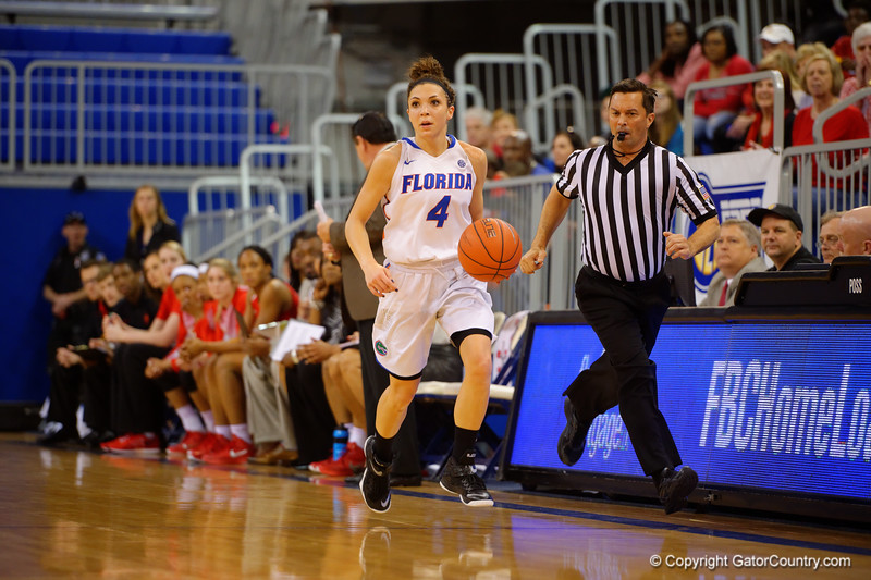 Florida Gators guard Carlie Needles dribbles up court durin the second half.  Florida Gators Womens Basketball vs Georgia Bulldogs.  February 28th, 2015. Gator Country photo by David Bowie.