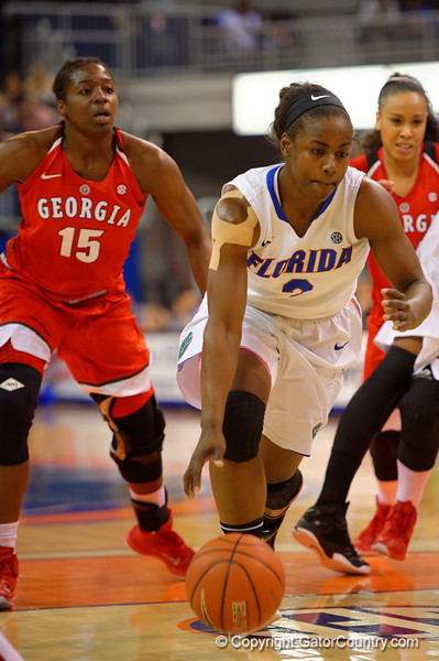 Florida Gators guard January Miller dribbles up court during the first half.  Florida Gators Womens Basketball vs Georgia Bulldogs.  February 28th, 2015. Gator Country photo by David Bowie.