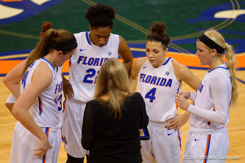 Florida Gators head coach Amanda Butler gathers her team together during a timeout.  Florida Gators Womens Basketball vs Georgia Bulldogs.  February 28th, 2015. Gator Country photo by David Bowie.