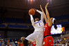 Florida Gators guard Ronni Williams leaps up and over a Georgia defenseman for the basket.  Florida Gators Womens Basketball vs Georgia Bulldogs.  February 28th, 2015. Gator Country photo by David Bowie.