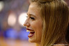 A Florida Gators Dazzler flashes her beautiful smile to her friend next to her.  Florida Gators Womens Basketball vs Georgia Bulldogs.  February 28th, 2015. Gator Country photo by David Bowie.