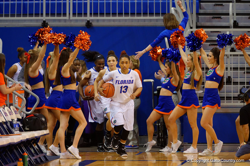 Florida Gators guard Cassie Peoples leads the Florida Gators onto the court.  Florida Gators Womens Basketball vs Georgia Bulldogs.  February 28th, 2015. Gator Country photo by David Bowie.