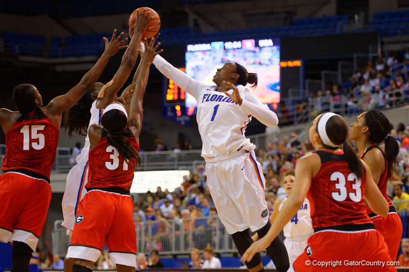 Florida Gators guard Ronni Williams leaps and comes away with an offensive rebound during the first half.  Florida Gators Womens Basketball vs Georgia Bulldogs.  February 28th, 2015. Gator Country photo by David Bowie.
