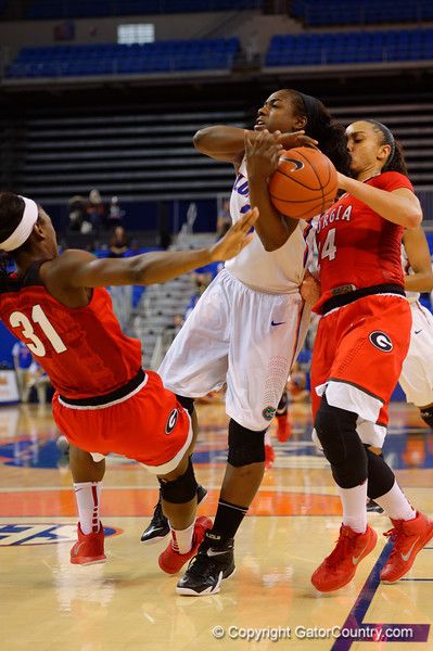 Florida Gators guard January Miller is called for a charge during the second half.  Florida Gators Womens Basketball vs Georgia Bulldogs.  February 28th, 2015. Gator Country photo by David Bowie.
