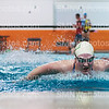 Practicing the butterfly, senior Claire Williams takes a breath during Friday morning practice on April 3 in the pool. Williams plans to attend NYU for swim next year.