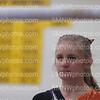 Junior Leah Steinaker examines the bar at the Varsitiy Gymnastcs meet on Saturday, Oct. 17 at Newton High School. The Gymnastics team went on to win the second place alround.