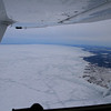 Looking down the frozen shore toward Green Bay.  Oconto River empties into the lake lower right.