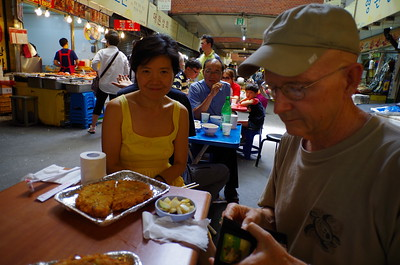 Wayne and Wenjing eating Mung bean pancakes