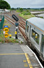 The 1615 Cork - Midleton passes signal CE473 at Glounthaune. This is a searchlight type signal so assist drivers in sighting it due to the footbridge. Fri 04.07.14