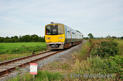 2809 + 2810 pass Quakers Road Level Crossing with the 1900 Ballybrophy - Limerick via Nenagh. Thurs 17.07.14