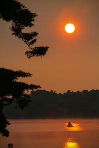 Sun rises over buoy number one for the Sprint Tri in Sanford Lake.
