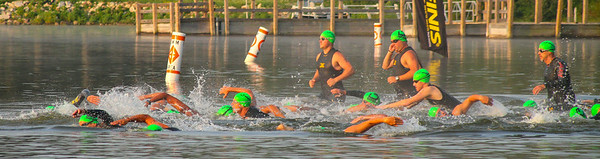 Men's Olympic Triathletes break from the beach on the first leg at Sanford and Sun.