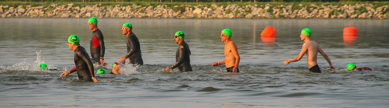 Olympic Triathletes start their swim leg on Sanford Lake.