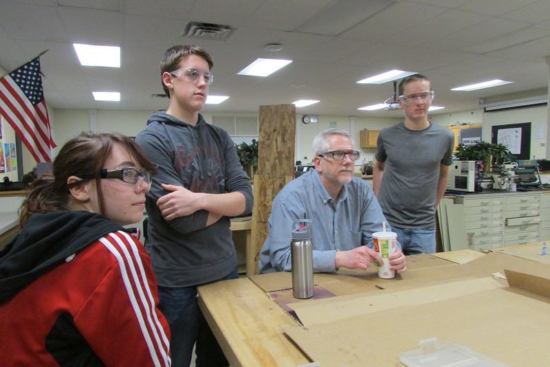 Team members listen to rookie question about their item cube