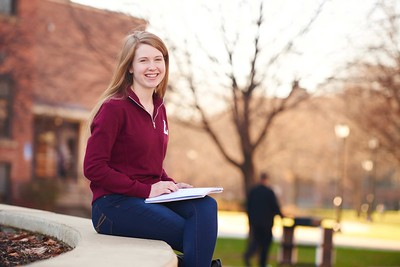 -UWL UW-L UW-La Crosse University of Wisconsin-La Crosse; day; December; Eagle L; Graff Main Hall; Notepad; Outside; Portrait; Smiling; Student students; Studying; sunny; Woman women