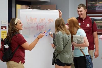 Buildings; Cartwright; Activity; Socializing; Objects; Whiteboard Chalkboard; People; Vanguards; Student Students; Summer; June; Time/Weather; day; Type of Photography; Candid; UWL UW-L UW-La Crosse University of Wisconsin-La Crosse; Location; Inside