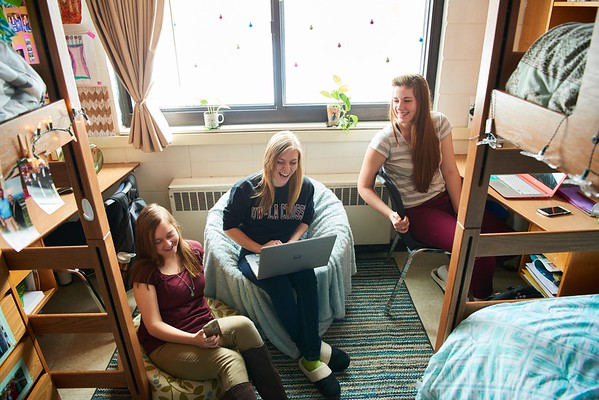 Activity; Socializing; Talking; Smiling; Buildings; Coate Hall; Dorm; Location; Inside; Objects; Chair; Bed; Books; Desk; Phone Cell Smartphone iPhone; Computer; People; Student Students; Woman Women; Type of Photography; Candid; UWL UW-L UW-La Crosse University of Wisconsin-La Crosse; Winter; January; Time/Weather; day