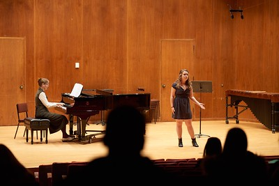 Activity; Music; Buildings; Center for the Arts CFA; Location; Inside; Objects; Band; People; Student Students; Winter; December; UWL UW-L UW-La Crosse University of Wisconsin-La Crosse; Type of Photography; Candid; Time/Weather; day; Singing; Woman Women