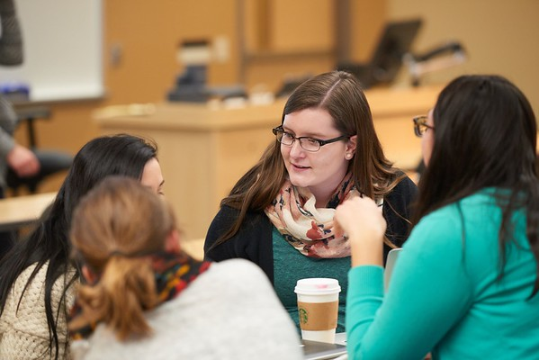 Activity; Collaboration; Research; Smiling; Speaking; Teaching; Buildings; Centennial; Location; Classroom; Inside; Objects; Chair; People; Student Students; Type of Photography; Candid; Group; UWL UW-L UW-La Crosse University of Wisconsin-La Crosse; Winter; February; Woman Women