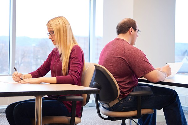 Pre-medical students Ali Lohr and Adam Wuensch engage in one of the mini-interview challenges that allow admissions committee members to evaluate communication skills of applicants.