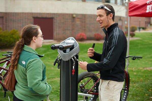 "Bike; Biking; Candid; cloudy; Club; day; Daytime; Fall; Group; Man men; November; Outside; ""Recreational Eagle Center; REC""; Speaking; Student students; Woman women"