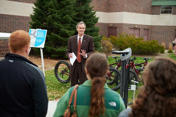 "Bike; Biking; Candid; Chancellor Joe Gow; cloudy; Club; day; Daytime; Fall; Group; Man men; November; Outside; ""Recreational Eagle Center; REC""; Speaking; Student students; Woman women"