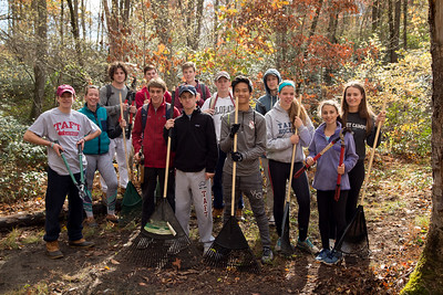 Students work clearing a campsite at Litchfield Montessori School for Community Service Day.