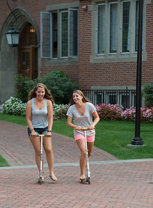 September 8, 2015: Taft_Student Fun.  Bella Horseman '16, left, and Paige Whittemore '16 enjoy riding their scooters around campus. (Photo by Robert Falcetti/Taft)