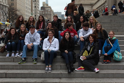 Students and sponsors pose in front of the MET