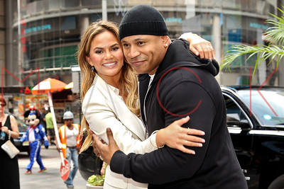 """NEW YORK, NY - JULY 13:  LL Cool J and Chrissy Teigen ring the NASDAQ Opening Bell to celebrate the hit series """"Lip Sync Battle"""" at NASDAQ MarketSite on July 13, 2015 in New York City."""