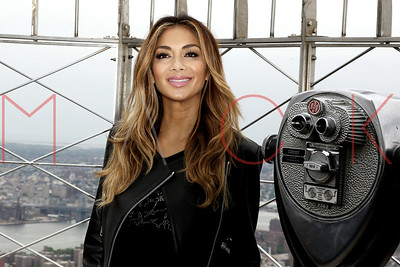 New York, NY - May 21:  Nicole Scherzinger lights the Empire State Building, New York, USA.