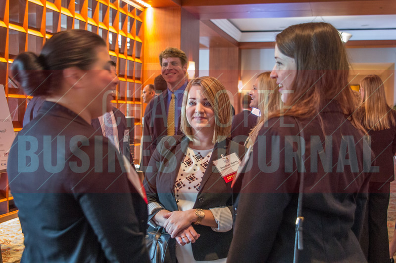 Attendees of the 2015 CBJ CFO Awards, held at the Westin Hotel, network and explore various booths before the ceremony begins.