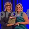 Linda Stanley, of Bank Of America Merril Lynch (left), and Small Private Company CFO Of The Year Amy McKelvey of Carcocon Corporation.
