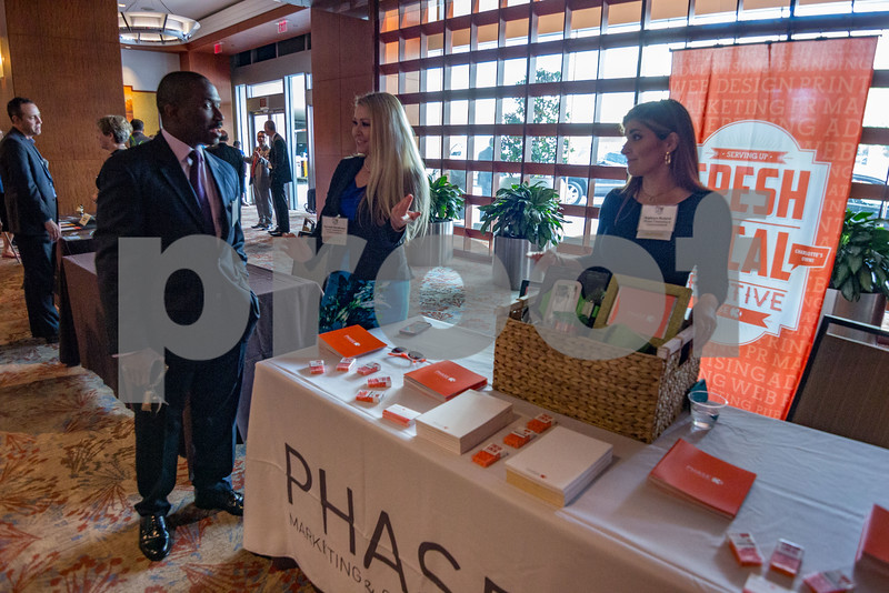 Attendees of the 2015 CBJ CFO Awards network and explore various booths before the ceremony begins.