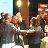 Attendees networking before the event