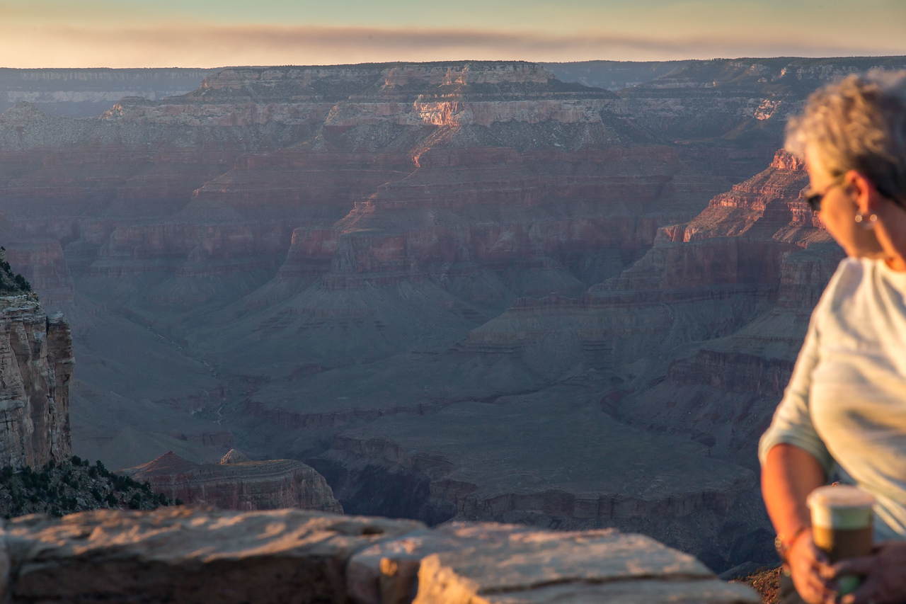 Cathy, at the small circular overlook by the E l Tovar ,taking in the sunset on the South Rim of the Grand Canyon and she was drinking coffee?
