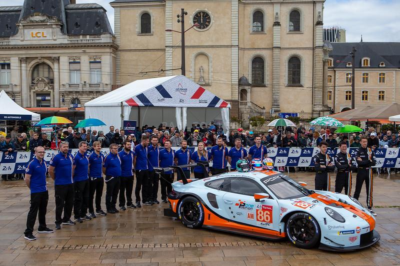 #86 Gulf Racing Porsche 911 RSR: Michael Wainwright, Benjamin Barker, Thomas Preining, Le Mans 24 Hours Public Scrutineering, Place de la République, Le Mans, France