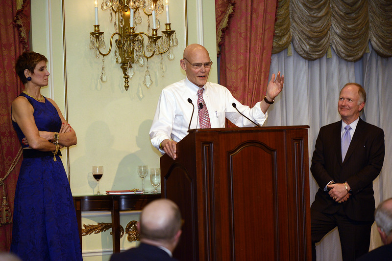 Mary Matalin and Bill Griffeth look on while James Carville regales the audience with an engaging story.